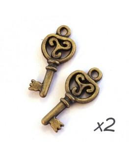 Breloque clé triskel bronze