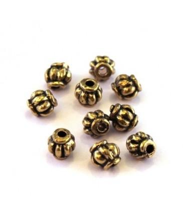 Perle métal striée 4mm dorée