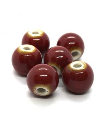 Perle céramique ronde 10mm rouge moucheté
